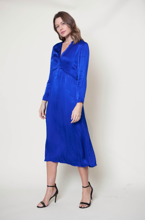 A beautiful pop of color from Raquel Allegra. Front button closures, v-neckline and fray finishing at waist and hem.  55% viscose, 45% rayon.