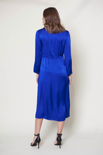 Load image into Gallery viewer, A beautiful pop of color from Raquel Allegra. Front button closures, v-neckline and fray finishing at waist and hem.  55% viscose, 45% rayon.