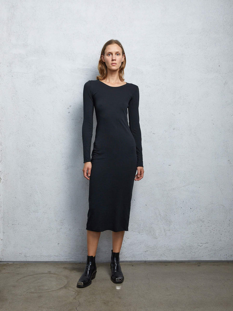Classic jersey long sleeve fitted dress in solid black.   Material: 100% Cotton / Hand Wash  Marike is 5'11
