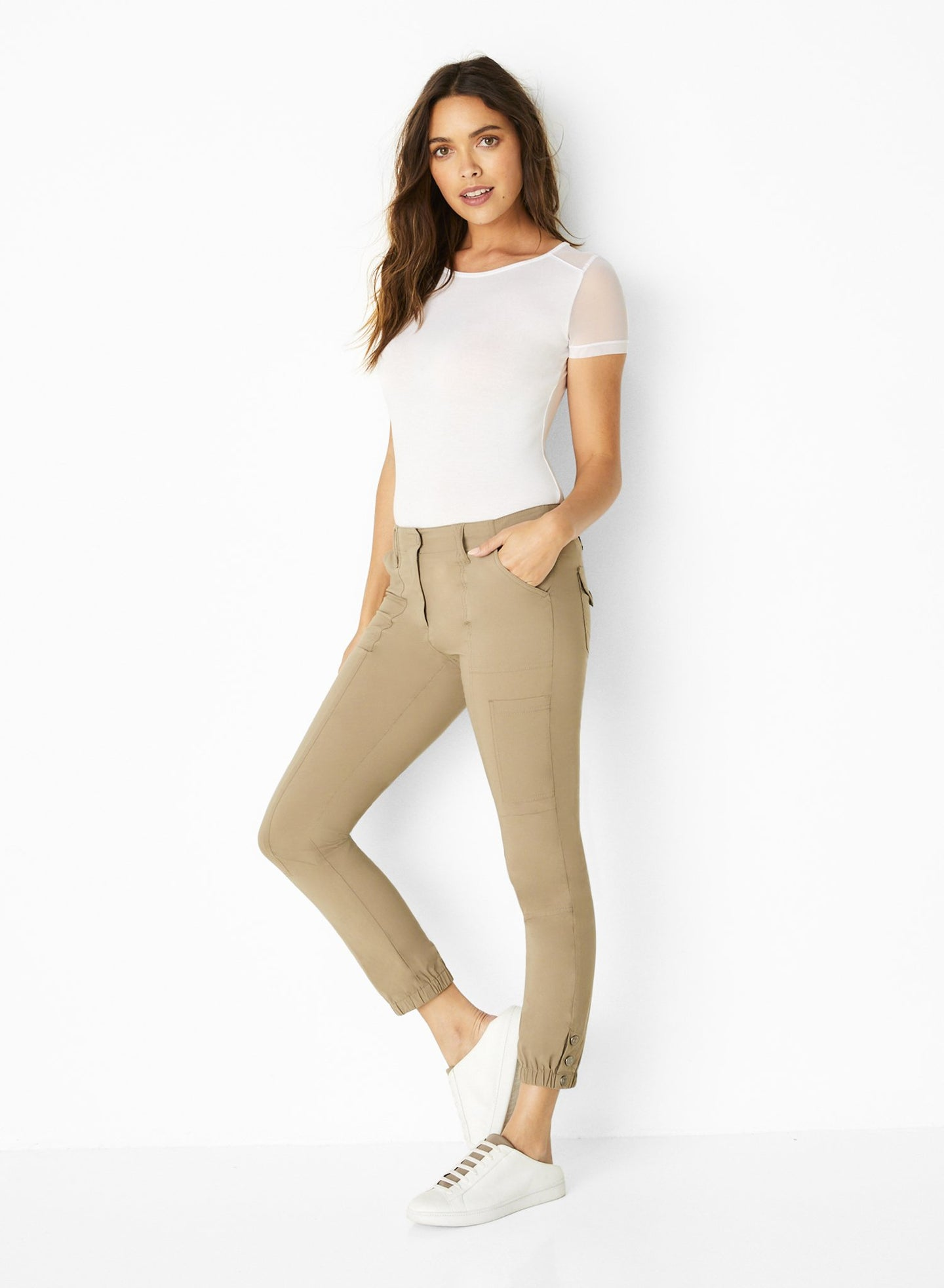 Slim fit Low-rise waistband Hidden zip-front closure with snap button Classic cargo pant design Slip pockets at the hips Cargo pockets at the legs Full-length relaxed legs with cuffs Wrinkle-free signature stretch fabric Imported: 59% Cotton /37% Polyester /4% Elastane UV Protection: 40+ Made in Italy