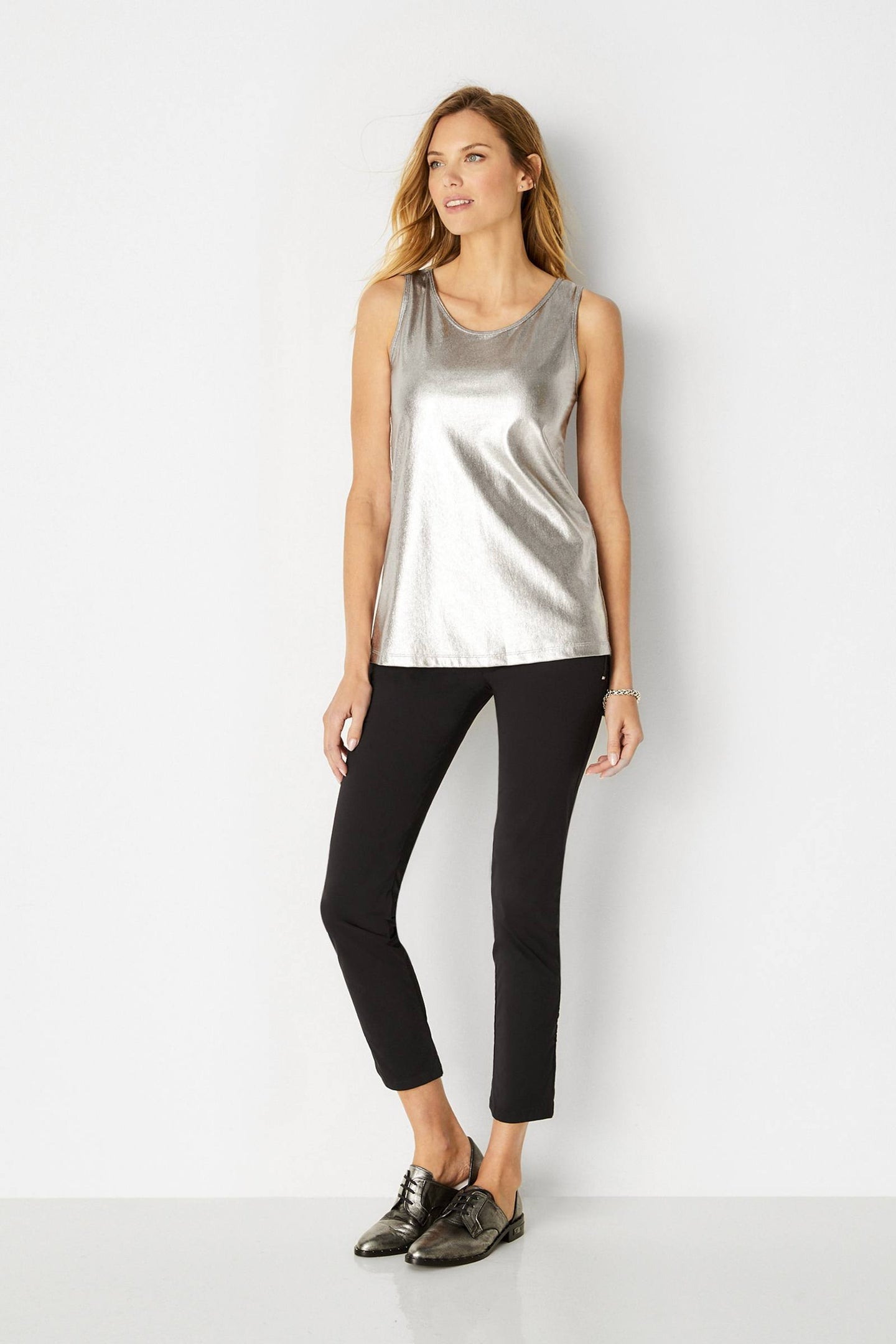 Relaxed fit Rounded scoop neckline Sleeveless design Luxe metallic finish Slightly extended length hits just below the waistline Wrinkle-resistant Imported: 92% Polyester / 8% Elastane Made in Italy