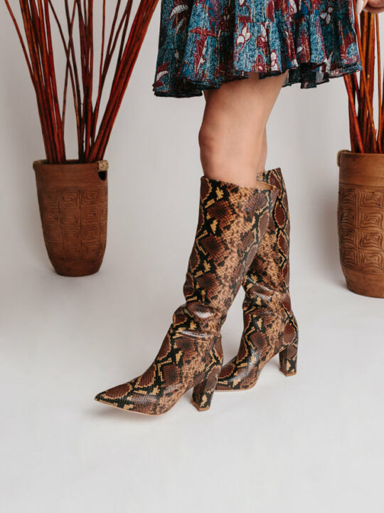 Ulla Johnson snake skin tall boot. Color combination is light brown, dark brown, and black.