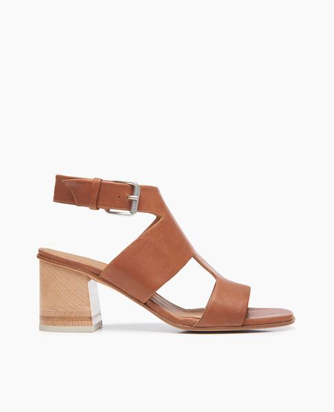 A substantial and secure t-strap offers the Berry sandal a modern streamlined look atop our newest tonal wood-inlay heel. In a soft, vegetable-tanned cuoio leather. Large buckle closure.