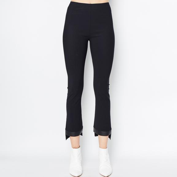High waisted with elastic waistband Cropped flare with vegan leather step hem trim EK Signature Tech Stretch 94% nylon, 6% lycra/polyurethane. Hand/machine wash cold on gentle cycle then lay flat to dry, or dry clean. Made in Japan