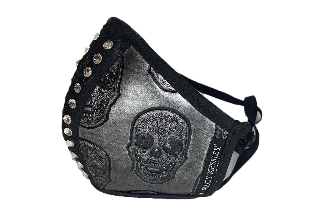 Pewter Skull Mask with Swarovski Crystals  Add some glam to your protective gear with the Swarovski Crystal Metallic Mask! The NEW essential that attaches to your Stacy Kessler bag! Our masks are soft, adjustable, and gender-neutral. With an extra pocket inside you can put any breathable filter to protect you and the people around you. Available in black, silver, or gold so you can mix and match and attaches your Stacy Kessler bag!  Why We Love It   Luxurious, metallic fabrics Attaches to handbag's interior