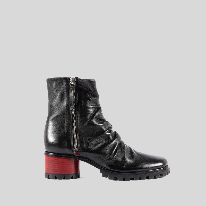 Demi-boot in black calf leather lateral zip red passion heel, asymmetric last. Personalized Leather and rubber sole. Heel 50 mm.