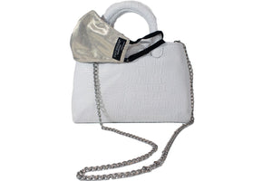 "The NEW Stacy Bag, perfect summer staple, is sexy and sophisticated. This bag is the perfect companion where ever you go this summer!  Why We Love it:  All in one Day to night with an optional crossbody Roomy enough for a laptop  Sexy for an evening out. Made in the USA PETA Charitable Measurements:  13""H x 8""W"