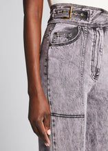 "Load image into Gallery viewer, Ulla Johnson ""Albie"" jeans in acid-washed denim with front and back seams. Adjustable waist belt; zip fly. High waist. Front and back patch pockets. Wide legs. Cotton. Imported."