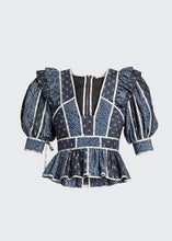 "Load image into Gallery viewer, Ulla Johnson ""Nori"" top in patchwork silk-blend. Plunging neckline. Short puff sleeves. Fitted. Peplum hem. Back zipper. Viscose/silk. Dry clean. Imported"