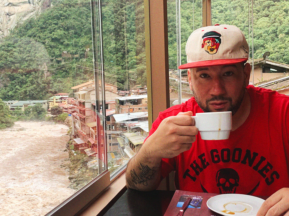Photo of Eff Yoo sippin coffee somewhere's in Peru
