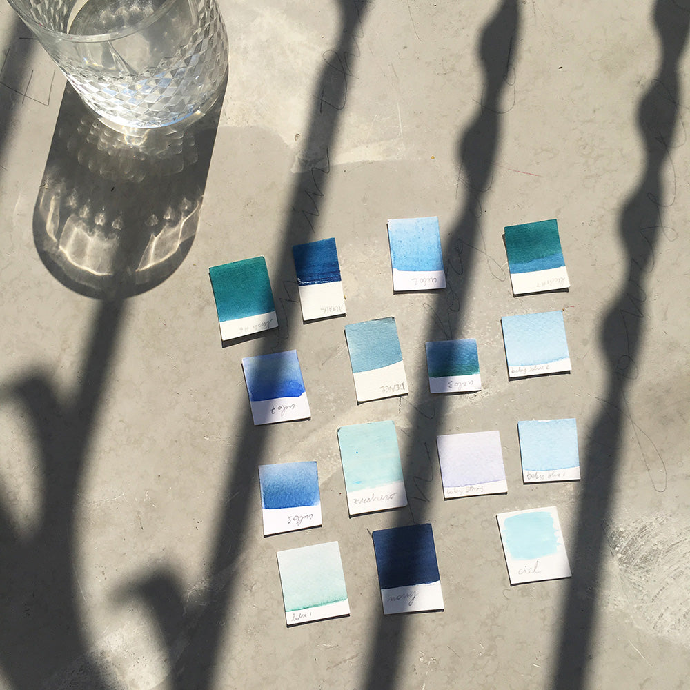 PPainting color swatches on the balcony by Marta Grossi.