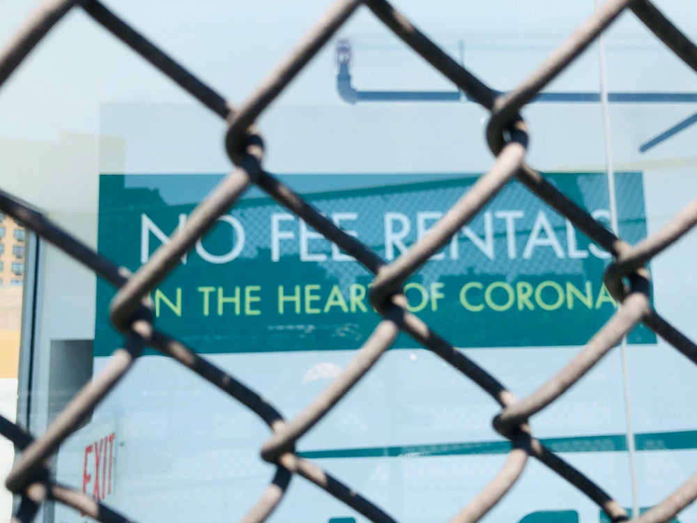 Photo by Matt of a sign, 'No Fee Rentals In The Heart Of Corona'