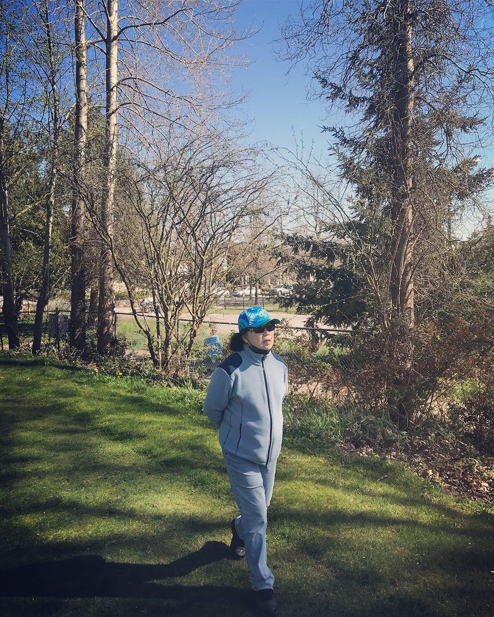 SPITGAN WEBZINE #3 Photo 3. Mom wears STR3AK CLothing tie dye cap walking on the Langara Golf Course, Vancouver, BC