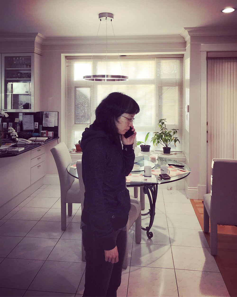 SPITGAN WEBZINE #3. Photo 7. Sis on the phone at home. Vancouver BC