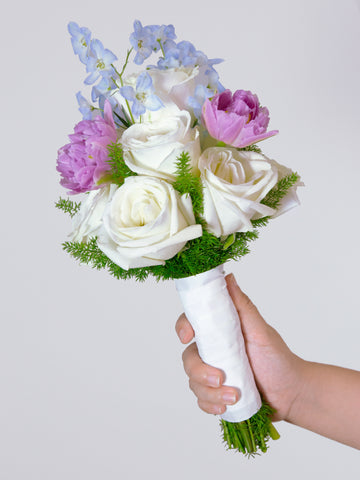 Bridal bouquet made of white imported roses and tulips