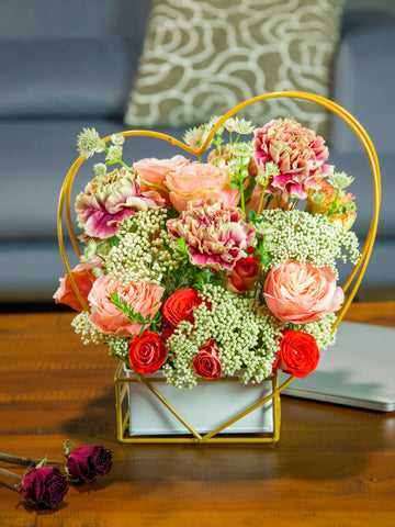 flower stand with roses, spray roses, carnation