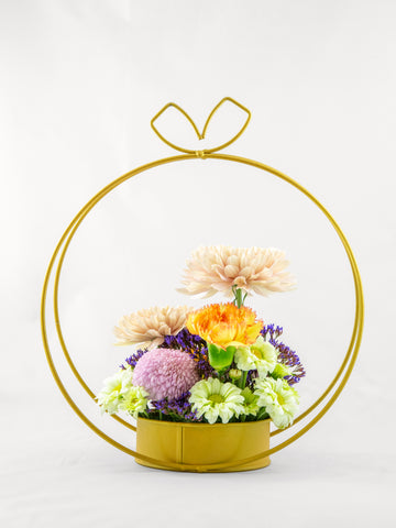 flower stand filled with gorgeous chrysanthemums and carnations