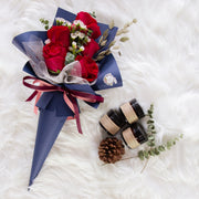 Cone shaped red roses bouquet in navy blue paper wrapper