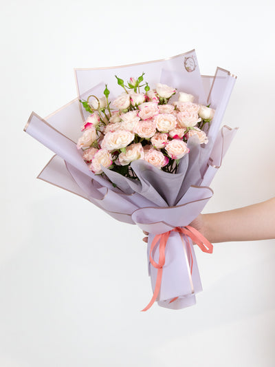 White spray roses with pinkish red tips bouquet