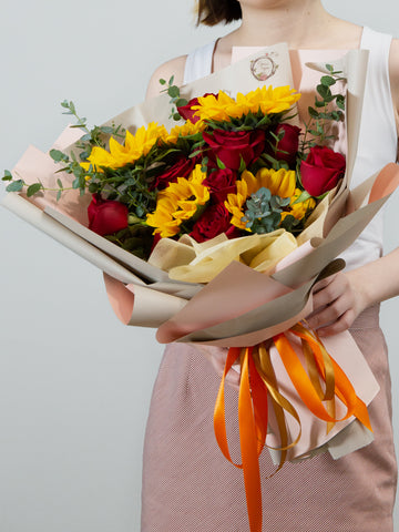 sunflower and red roses bouquet