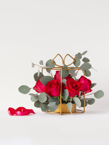red roses and silver dollar eucalyptus in hand-made mini stand