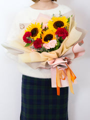 sunflowers, carnations, and roses in one bouquet