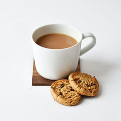 Why do the British dunk biscuits in tea?