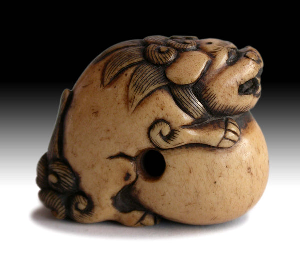19th Century Japanese Carved Kara Shishi Temple Lion on Ball Stag Antler Netsuke