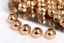 Load image into Gallery viewer, Gold Filled - Rose Gold 3.0mm Seamed Round Bead. Sold as - 50 Pieces Per Pack