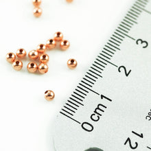 Load image into Gallery viewer, Gold filled - Rose Gold 4.0mm Seamed Round Bead. Sold as - 30 Pieces Per Pack