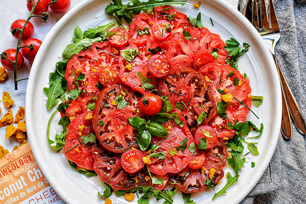Rawcology Inc | Simple Herb Tomato and Olive Summer Salad