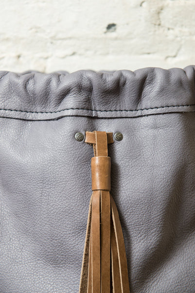 String Backpack in Dusk Grey Leather with Tassel