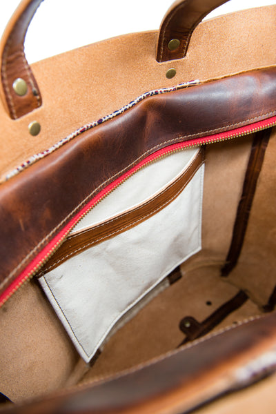 interior canvas pocket with leather trim