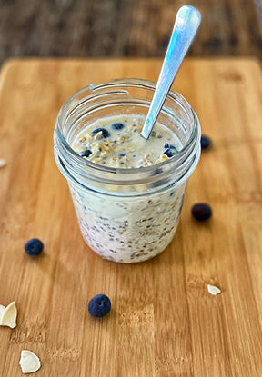 Jar of Overnight oats with chia seeds, pumpkin seeds and blueberries