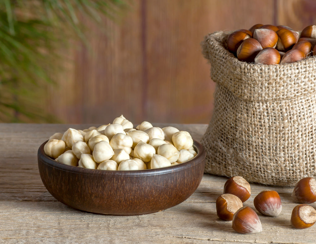 Bowl of hazelnuts on a wooden table