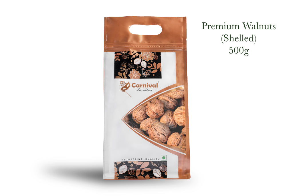 Packet of shelled walnuts on white background