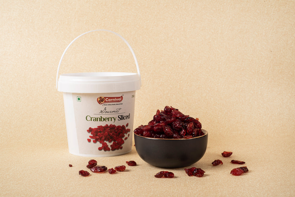 tub of carnival sliced cranberries next to bowl of sliced cranberries