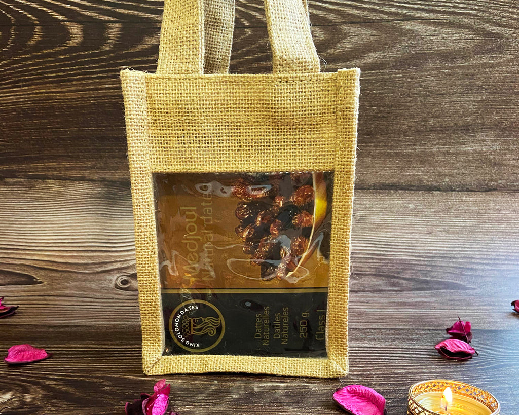 festive greetings gift bag on a wooden background