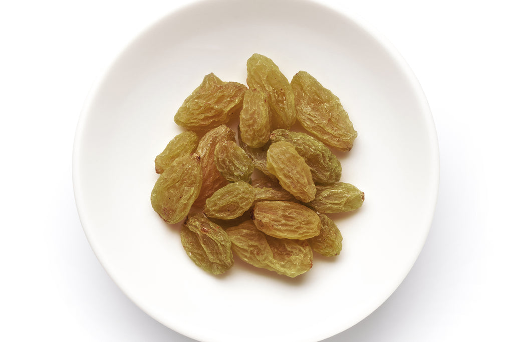Indian kishmish (raisins) on a white background