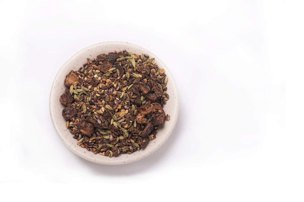 bowl of healthy flax seeds on a white background
