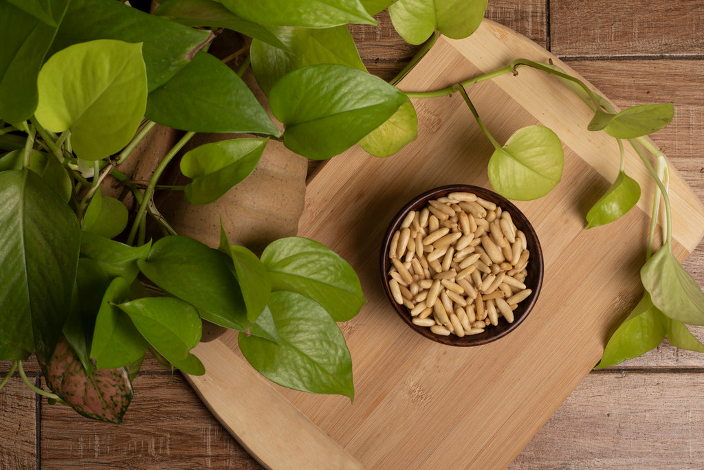 bowl of pine nuts on a wooden table