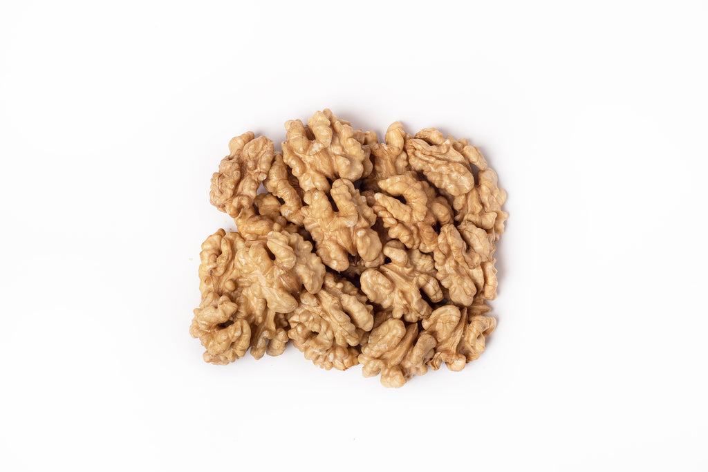 walnut kernels on a white background