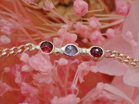 Gold bracelet with small 3mm red garnet and blue tanzanites