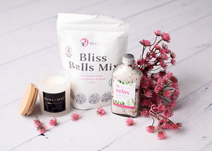 Candle, bliss balls, relax bath soak.