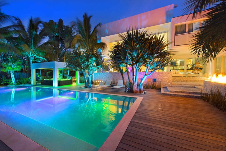 High-End-Luxurious-Modern-Mansion-with-Colorful-Lighting-at-Night-Located-in-Miami-homesthetics-Florida-37