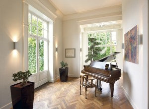 piano room with modern wall sconce