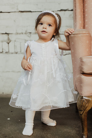 Girl Wearing White Lace Christening Gown