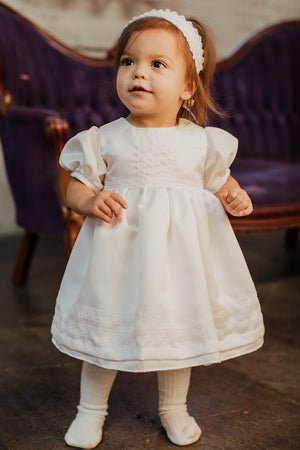 Baby Wearing a Puff-sleeve Baptism Dress