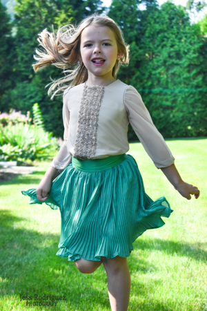 Girl playing in a Pleated Skirt and Brown Shirt
