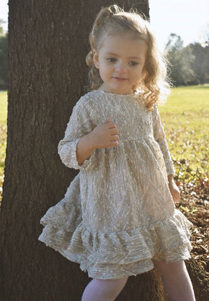 Curly Haired Girl Playing Behind a Tree